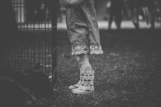 monochrome photography of children wearing boots
